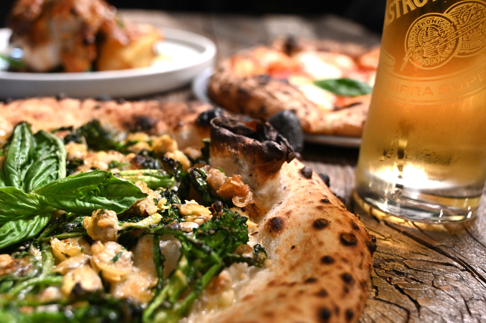 This is a photo of 3 Posto Italian signature dishes with a Peroni beer.