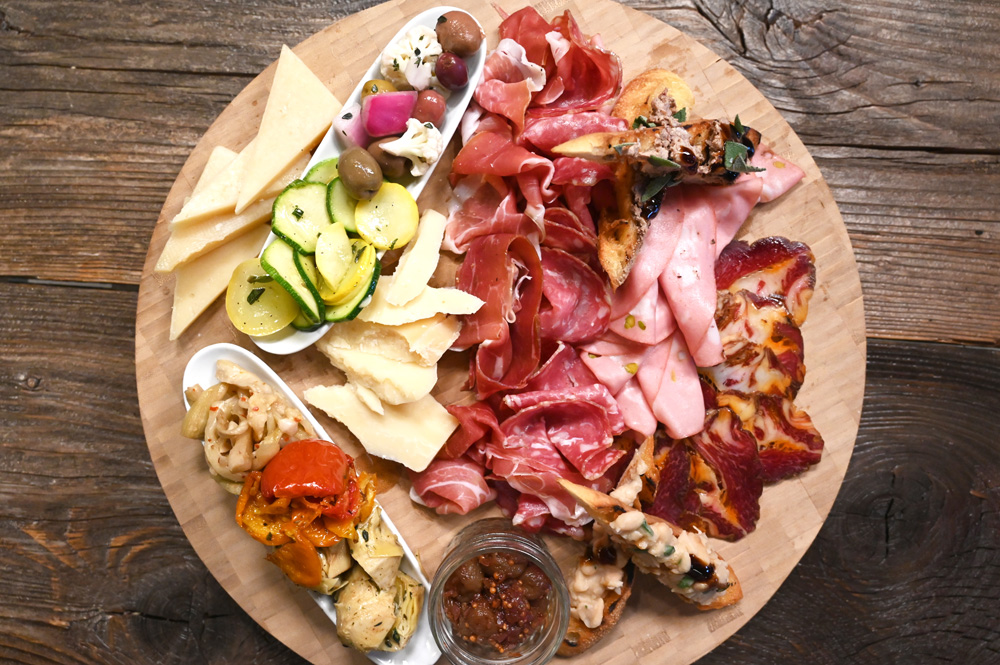 This is a photo of Posto Italian's meat and cheese board.