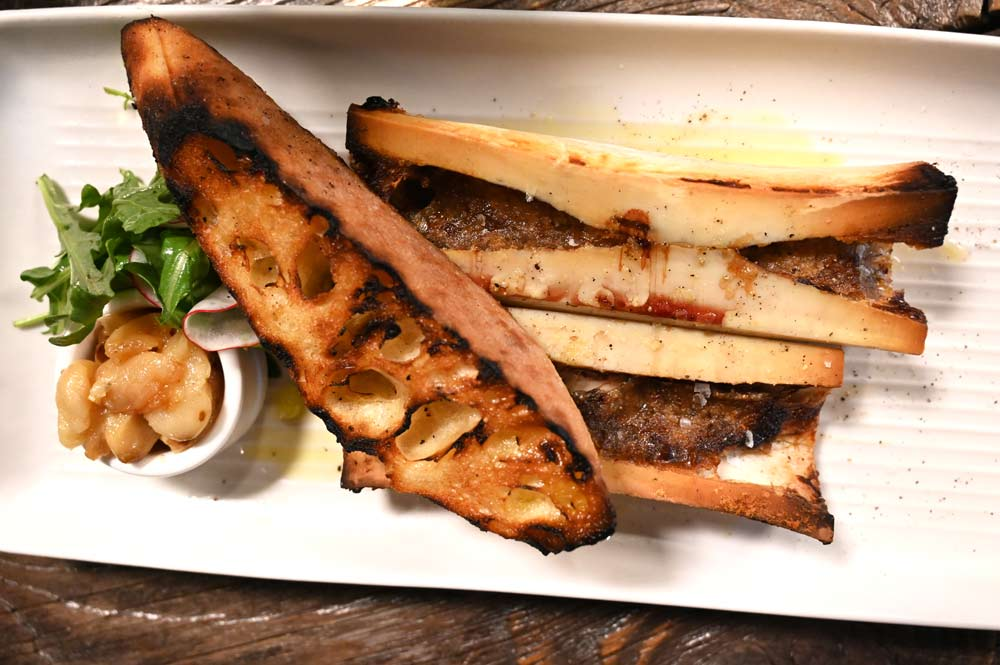 This is a photo of Posto Italian's wood roasted bone marrow.