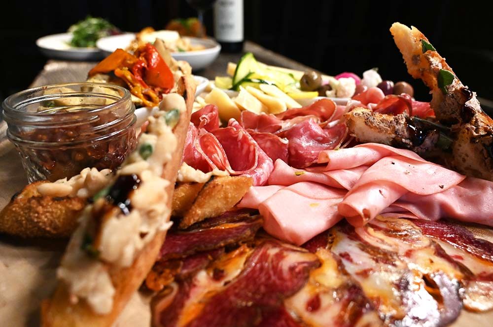 This is a photo of Posto Italians meat and cheese board.
