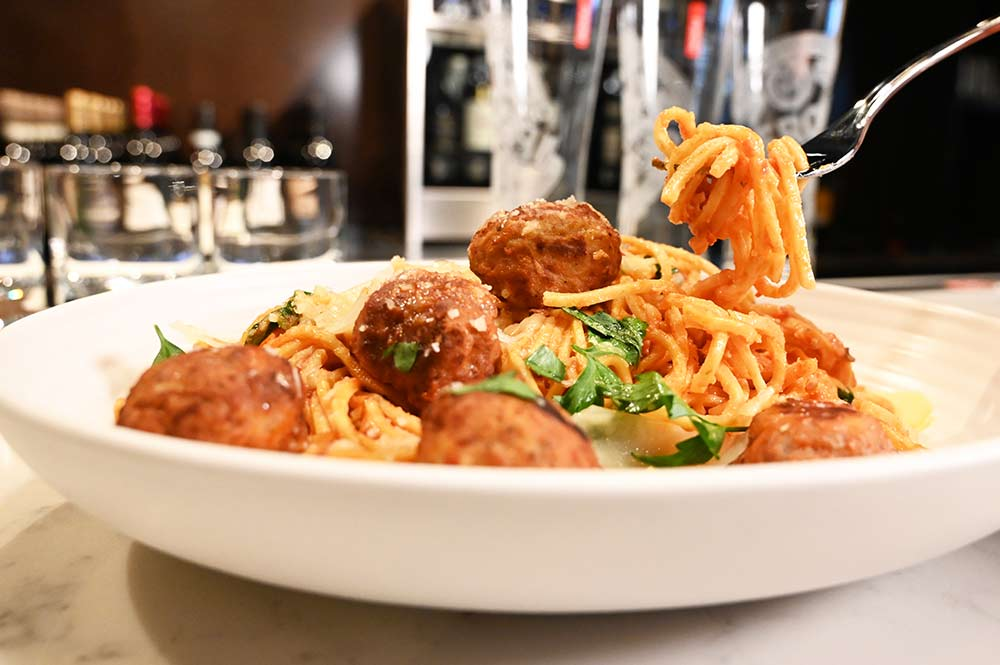 "This is a photo of Posto Italian's ""Old School"" spaghetti and meatballs."