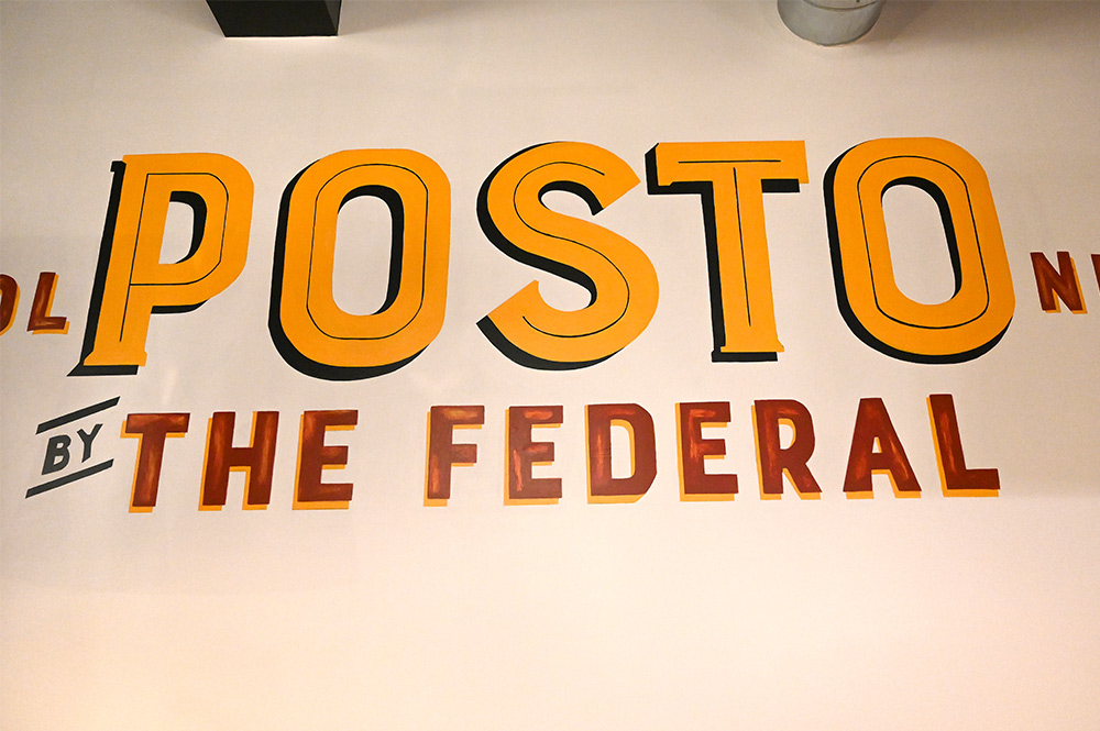 This is a photo of the Posto Italian logo on a wall.
